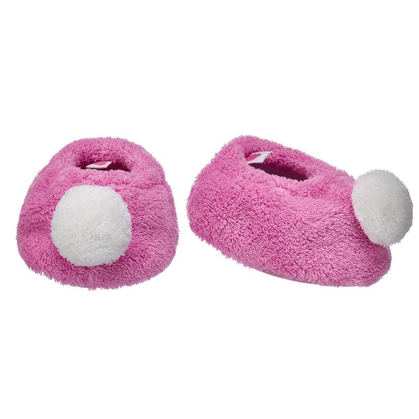 Keep your furry friend's paws extra warm before bed with this cute pair of slippers! These pink slippers have a fuzzy white pom on the toe.