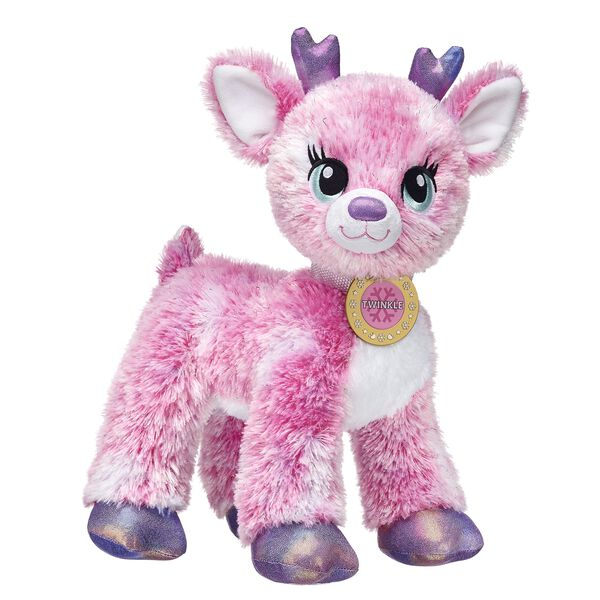 Twinkle the Supersonic Deer has a radiant personality that matches her pink fur! Twinkle comes with a signature name medallion. Add Twinkle's cape, tutu and sparkly shoes to make this stuffed reindeer even more charming!