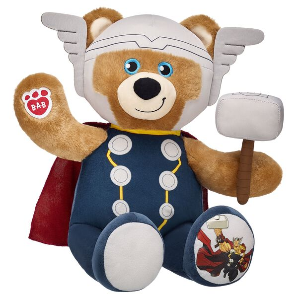 The mighty Thor controls thunder and lightning with his enchanted hammer. Thor Bear has a built-in costume with his hammer Mjolnir on his left paw
