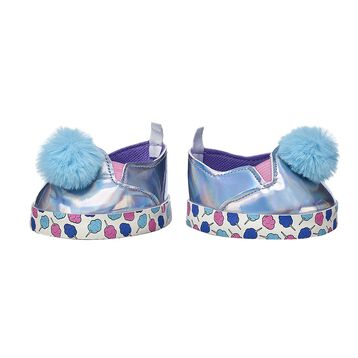 Your furry friend can put their best paw forward in this sweet pair of Kabu sneakers! These silver shoes have blue poms and a cotton candy print on the soles. Shop online or in store at Build-A-Bear Workshop!