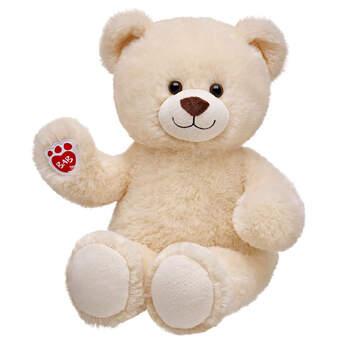 cream-coloured stuffed teddy bear sitting and waiving