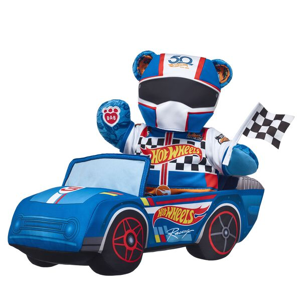 Wanna race? This rad gift set makes the ultimate surprise for any Hot Wheels™ fan or collector! Hot Wheels™ Bear comes fully dressed and ready to race in its plush Hot Wheels™ race car that includes built-in racing sounds. It's the ultimate way to commemorate the 50th anniversary of Hot Wheels™! <p>Price includes:</p>  <ul>    <li>Hot Wheels™ Bear</li>    <li>Hot Wheels™ Racing Outfit</li>    <li>Black Rubber Boots</li>    <li>Hot Wheels™ Plush Car</li>    <li>Black and White Chequered Flag</li> </ul> HOT WHEELS™ and associated trade dress are owned by, and used under license from, Mattel. ©2018 Mattel. All Rights Reserved.