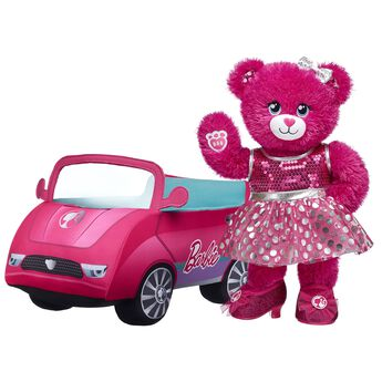 """This must-have gift set is sure to enchant Barbie™ fans of all ages! Barbie™ Bear comes fully dressed in her signature dress and sparkly heels. She can drive into more fun with her plush pink convertible too! <p>Price includes:</p>  <ul>    <li>Barbie™ Bear</li>    <li>Barbie™ Silver Polka Dot Dress </li>    <li>Barbie™ Fuchsia Sparkle Heels</li>    <li>Multicolor Sparkle Bow Set 4 pc.</li>    <li>Barbie™ Plush Pink Convertible </li> </ul>  ©2018 Mattel. All Rights Reserved."""