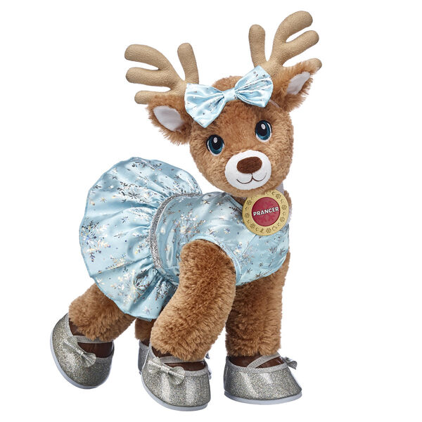 Nicknamed The Pitch-Perfect Planner, Prancer loves nothing more than singing merrily all holiday season long! This chic snowflake dress and bow headband create the perfect amount of winter shimmer. The silver sparkle flats add a frosty touch to this fashionable look!