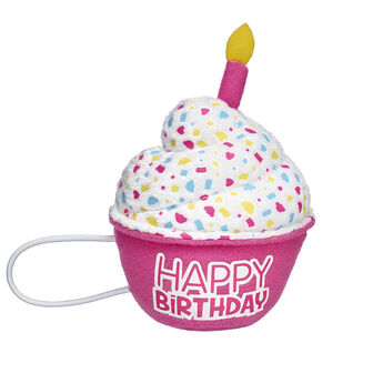 Blow out the candles on your cake! This special pink cupcake makes a sweet accessory for any furry friend. The colourful cupcake attaches to a furry friend's paws with elastic bands and has a pretend candle on top.