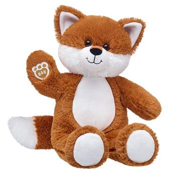 red fox stuffed animal sitting and waiving