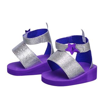 Make sure your Honey Girl is ready and stylin' when they hit New York City for their big concert! With purple bottoms and sparkly silver straps, these trendy sandals pair great with any Honey Girls outfit. A shiny purple star adorned on each strap provides the perfect amount of extra flair.
