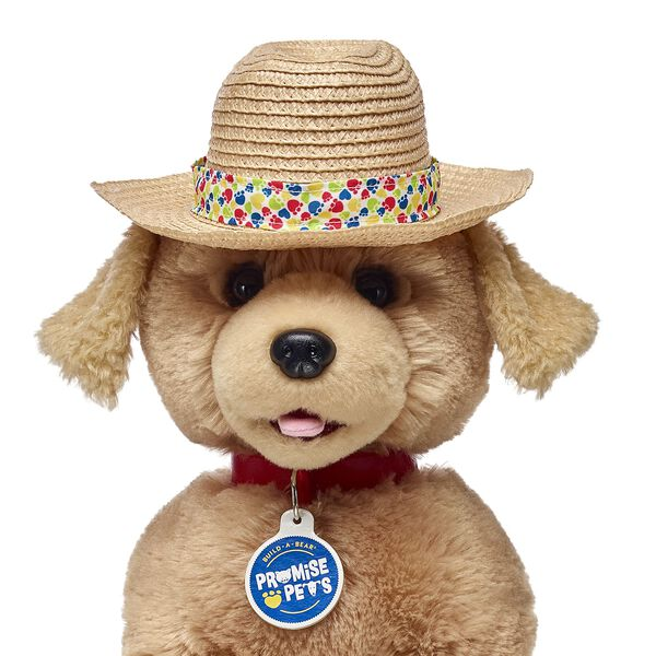 straw hat on dog stuffed animal