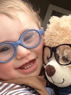Child And Stuffed Bear Both Wearing Glasses