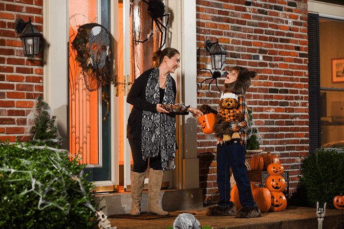 child receiving candy at halloween