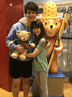 Couple Holding Stuffed Bear Together