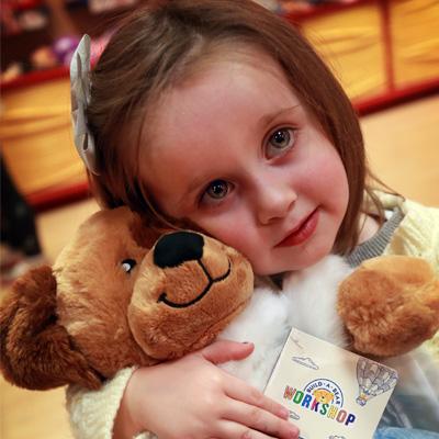 Girl hugging bear