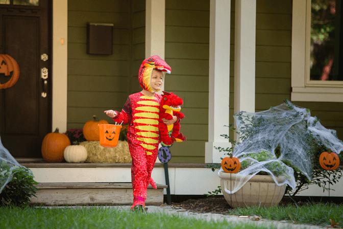 child in a dinosaur costume