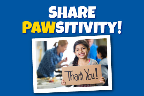 Share Pawsitivity - Child holding thank you sign
