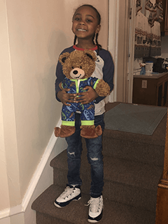 Child With Stuffed Bear in Pajamas