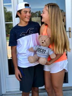 Boy and Girl Holding Bear