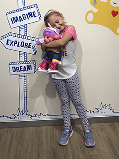 Child Hugging Stuffed Bear Tightly